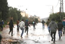 Palestinian youth battle with Israeli troops and settlers on the West Bank