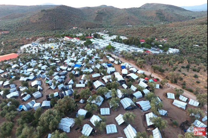 An aerial view of a makeshift settlement next to Moria camp on the island of Lesvos (Credit and copyright Giorgos Moutafis)