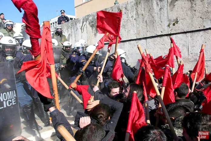 Riot police attack students on the stairs to the Vouli (Greek parliament) building in Athens last Thursday. Photo credit: MARIOS LOLOS