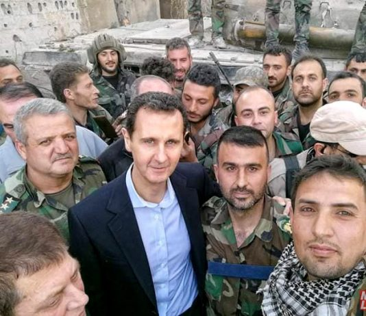 Syrian president BASHAR AL-ASSAD is welcomed by Syrian troops