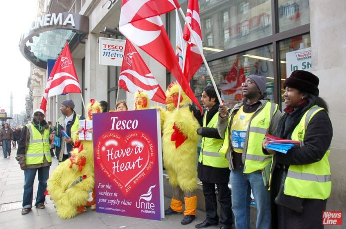 Unite Tesco supply workers protest outside a store in central London – 9,000 jobs are threatened as the company seeks to save £1.5bn