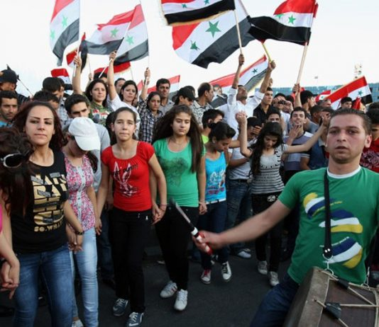 Syrian youth on a demonstration in support of President Assad – Syria supports the government of President Maduro in Venezuela