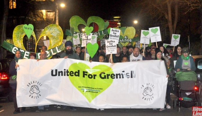 The front of the monthly London, England Silent Walk for Grenfell on Thursday evening – supported by large numbers of firefighters and students from Devon