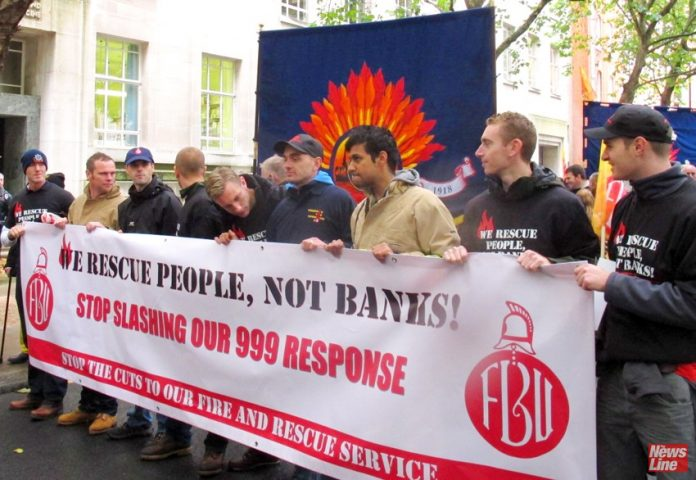 British firefighters marching against cuts to fire safety