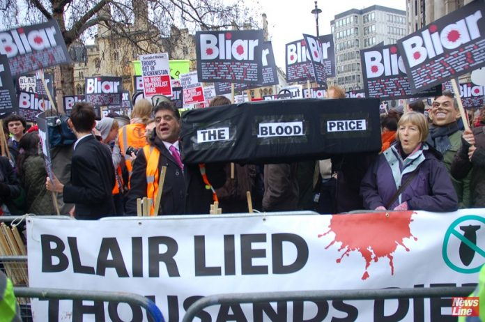 British demonstrators condemn Tony Blair outside the Chilcot Inquiry in 2010