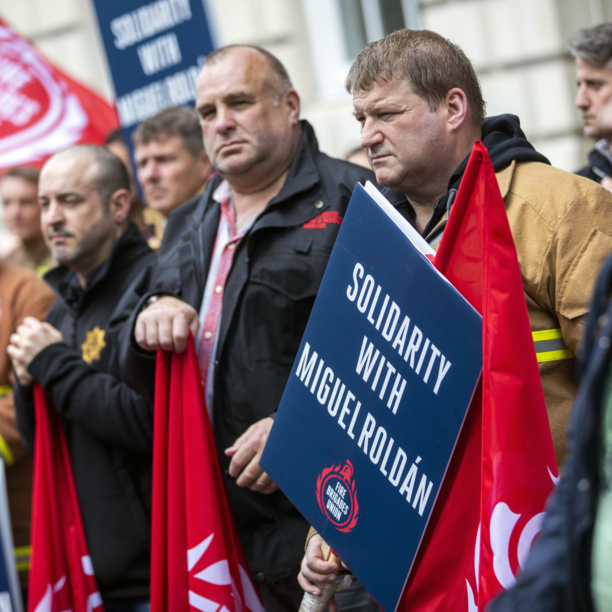Firefighters outside the Italian embassy in London, England last Thursday demanding the immediate release of Miguel Roldan who faces 20 years in jail for helping to save the lives of refugees. Photo credit: FBU