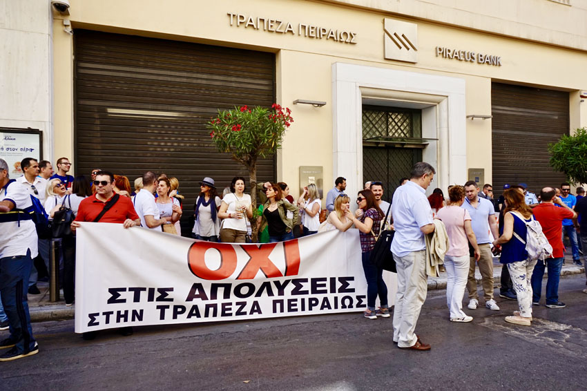 Bank workers on the picket line outside Piraeus bank in central Athens during their national strike last Friday