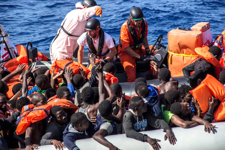 African refugees are rescued from a dinghy in the Mediterranean Sea
