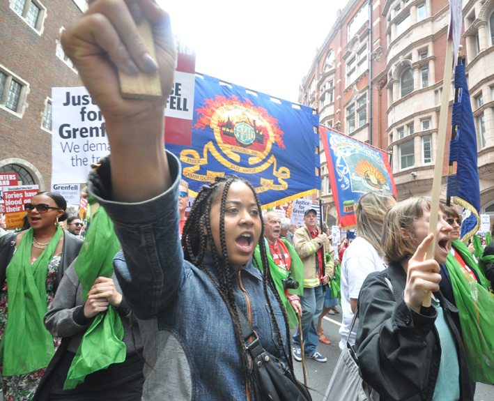 Young protester demanding justice for Grenfell on the FBU-Grenfell march on the first anniversary of the inferno