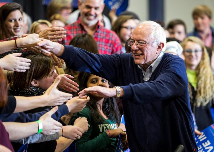 Supporters greet US presidential candidate Bernie Sanders