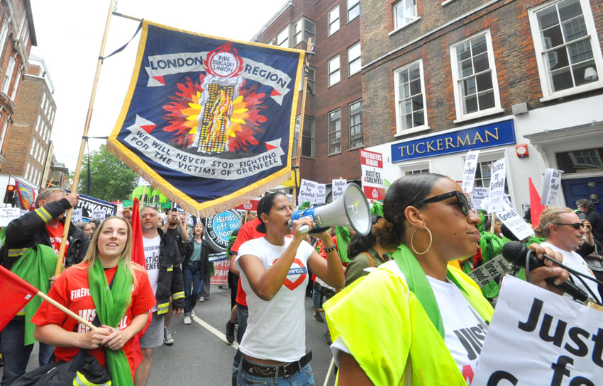 LUCY MASOUD (with megaphone) on the FBU-Justice4Grenfell march to Downing Street on the first anniversary of the London Grenfell inferno